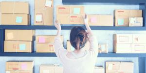 women stacking boxes
