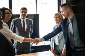 Group of business professional shaking hands