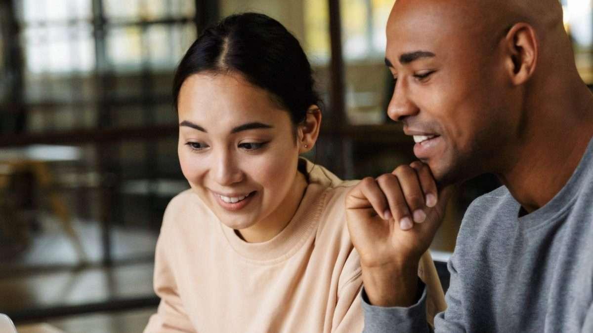 Man and woman looking at screen