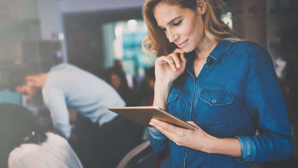 Businesswoman holding tablet in modern office