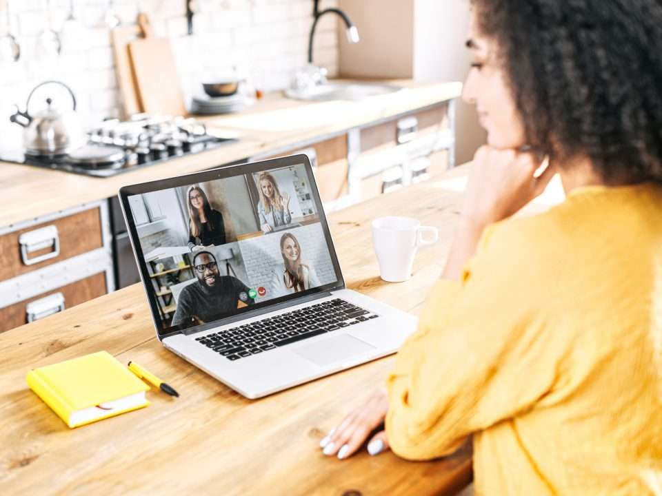 Woman on a laptop video call with four colleagues